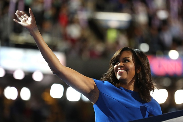 PHILADELPHIA, PA - JULY 25: First lady Michelle Obama acknowledges the crowd before delivering remarks on the first day of the Democratic National Convention at the Wells Fargo Center, July 25, 2016 in Philadelphia, Pennsylvania. An estimated 50,000 people are expected in Philadelphia, including hundreds of protesters and members of the media. The four-day Democratic National Convention kicked off July 25. (Photo by Joe Raedle/Getty Images)