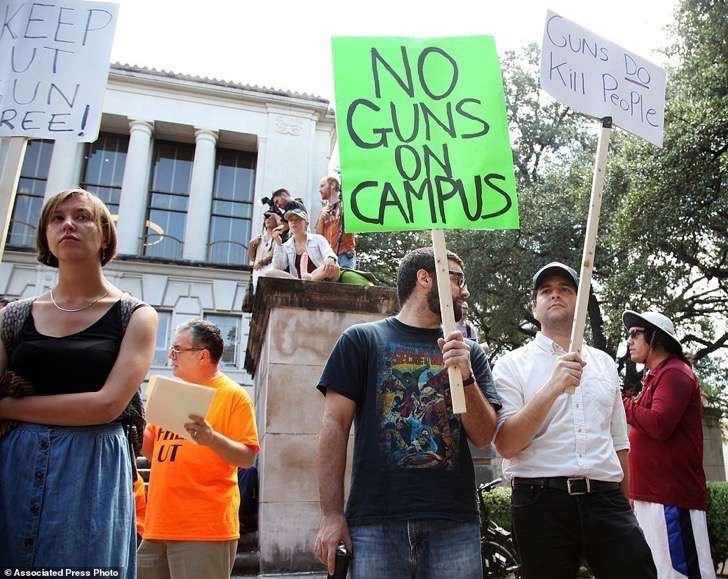 3z4eLzieBV2d0f8e018d6227decd-3756993-Students_holds_signs_and_sex_toys_as_they_protest_a_campus_carry-a-39_1472084711562 2