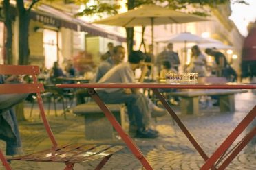 The scene on a Thursday night for apertivo, a drink and a snack before dinner. Here the action is in and around cafe Free Volo on Piazza Emanuela Filiberto in the popular and young Roman Quarter