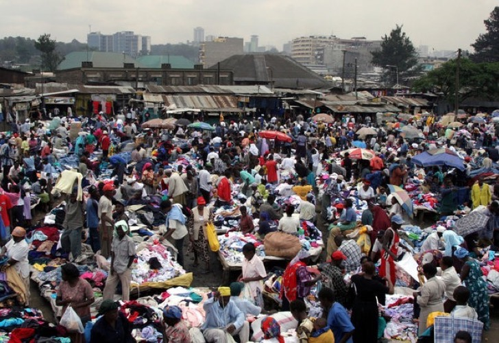 """Kenyans pick through second-hand clothes at the vast Gikomba street-market September 6, 2005. Despite widespread poverty across the east African nation of 32 million people, the last two decades have seen a roaring success in second-hand clothes trade known in local Swahili as """"mitumba."""" Shipped into Kenya in enormous quantities, vast piles of clothes are shifted at Gikomba, a teeming labyrinth of makeshift stalls, boxes, carts and barrows full of clothes and shoes in a densely-populate, pot-holed suburb of Nairobi. Picture taken September 6, 2005. REUTERS/Thomas Mukoya"""