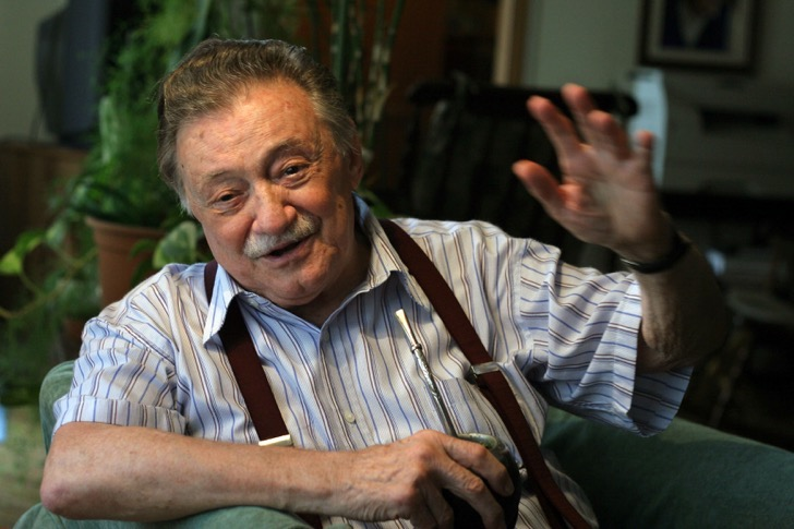 """FILE - Uruguayan writer Mario Benedetti gestures during an interview at his home in Montevideo on January 7, 2007. Benedetti died on May 17, 2009 at the age of 88 as a consequence of an intestinal disease. Born in 1920, Benedetti has written tales, poems, essays, theatre and novels and is one of Latin America's best known writers. The Argentine film based on his novel """"La Tregua"""" (The Truce) was nominated for an Oscar in 1974 for Best Foreign Language Film, while singers such as Spanish Joan Manuel Serrat and Uruguayan Daniel Viglietti have sung his poems. AFP PHOTO/PABLO BIELLI"""