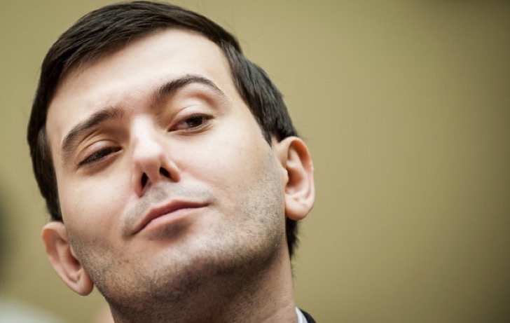 """Martin Shkreli, former chief executive officer of Turing Pharmaceuticals LLC, reacts during a House Committee on Oversight and Government Reform hearing on prescription drug prices in Washington, D.C., U.S., on Thursday, Feb. 4, 2016. Shkreli, who is no longer with Turing and faces federal fraud charges unrelated to the drugmaker, declined to make any comments to the committee. """"On the advice of counsel, I invoke my Fifth Amendment,"""" Shkreli said. Photographer: Pete Marovich/Bloomberg *** Local Caption *** Martin Shkreli"""